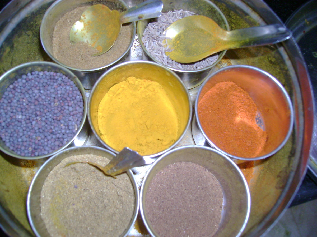 Cumin seeds in my masala box - the one with the big spoon in it :) The one next to it with the spoon is the powdered cumin
