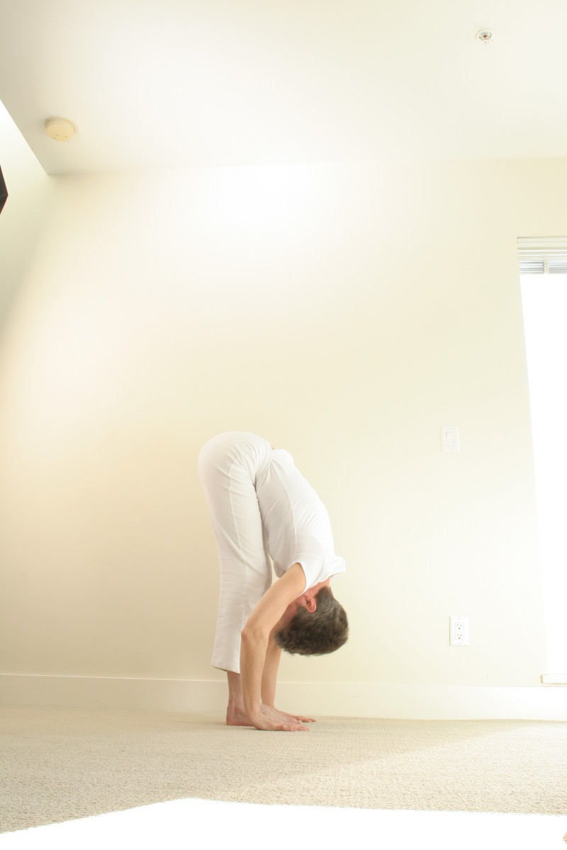 Standing Forward Fold.  If this variation is too deep, if you have high blood pressure, or if feel sick or dizzy in this position, use an easy variation with the hands on a chair, the bathtub edge, or the kitchen counter.