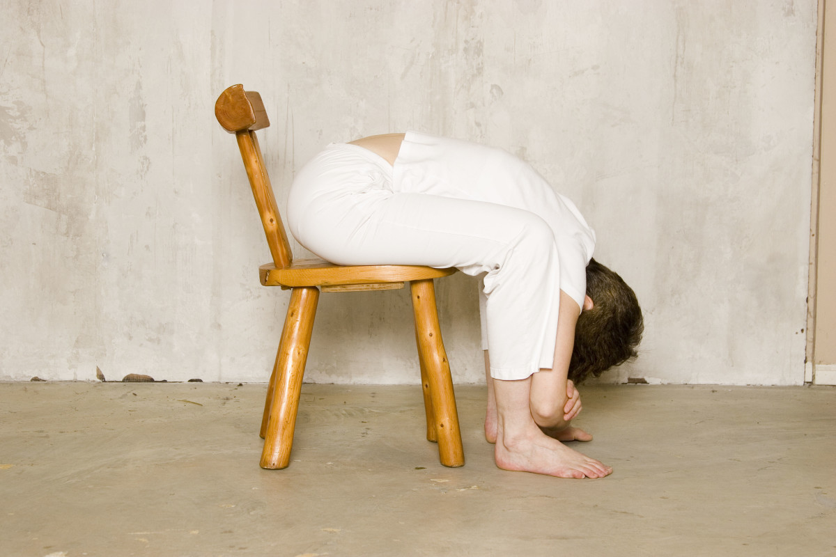 Seated Forward Fold in a Chair.  To come into the pose, rag doll down as you exhale, and only come as far forward as feels comfortable for you. If you have high blood pressure, keep the head above the heart and the elbows on the knees.