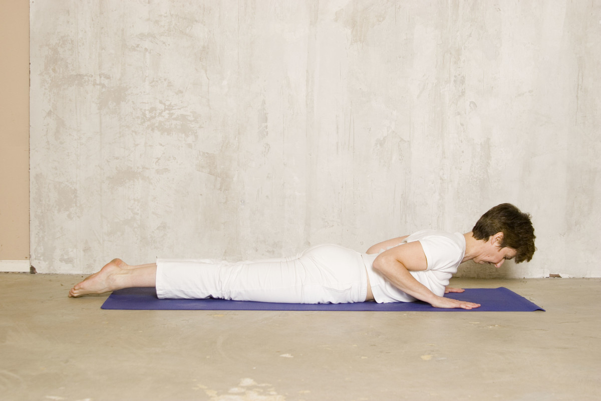 Reach forward and up through the top of the head to lengthen the spine as you come into Cobra.  Use the back and abdominal muscles to lift the upper body off the floor, not the arms.  Arch between the shoulder blades, not in the lower back.