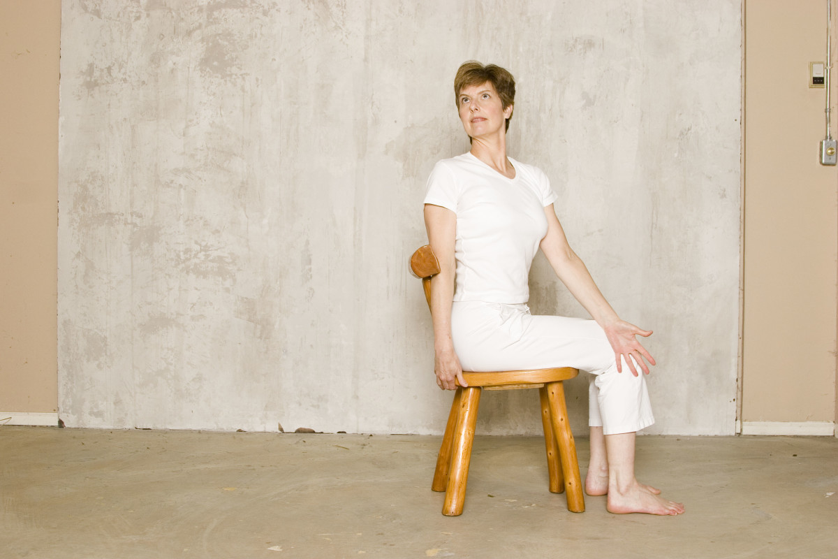 Seated Twist in a Chair.  As you inhale, lift the ribs away from the hips and lengthen the spine.  As you exhale, twist back gently leading the twist with the shoulder.
