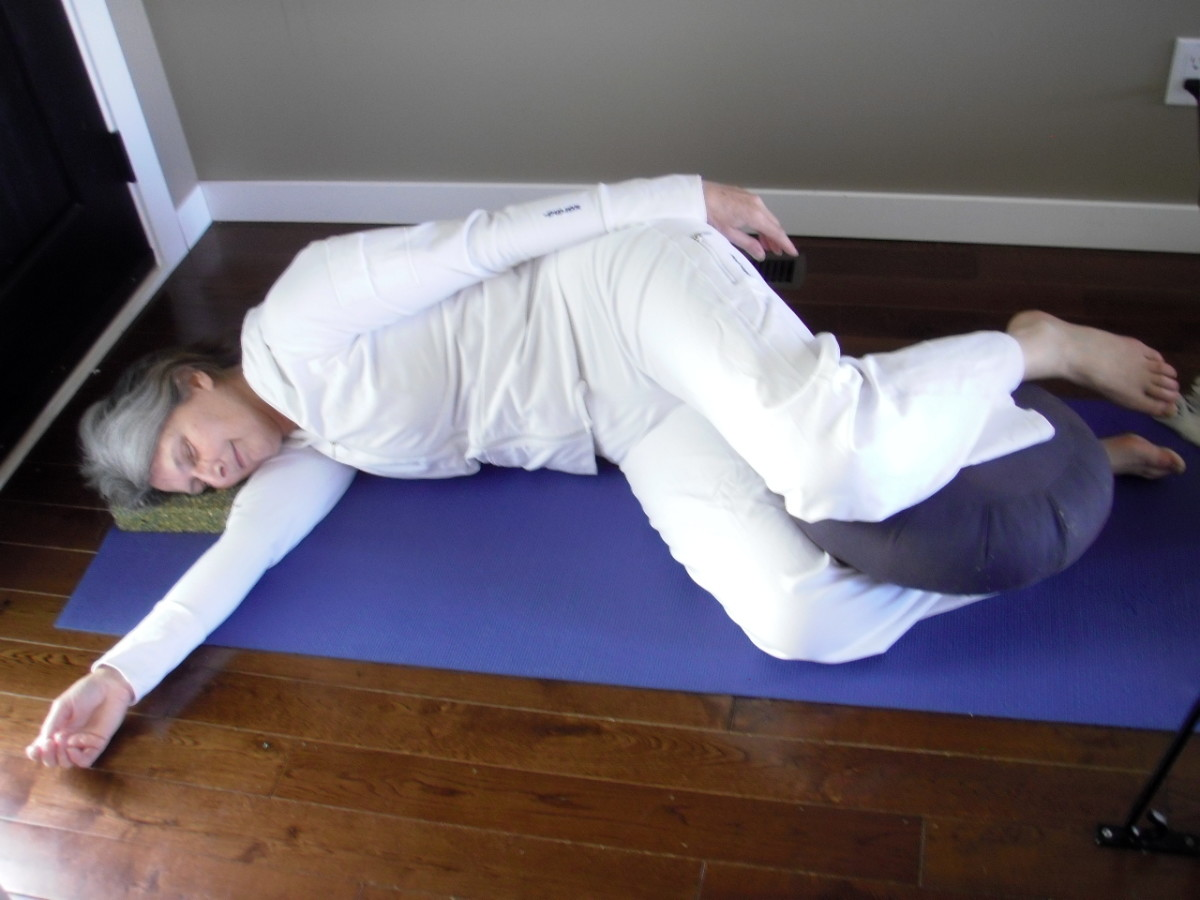 Lie on the side for final relaxation.  Use bolsters or cushions under the head and between the legs, or use a body pillow.  Cover yourself with a blanket to stay warm.