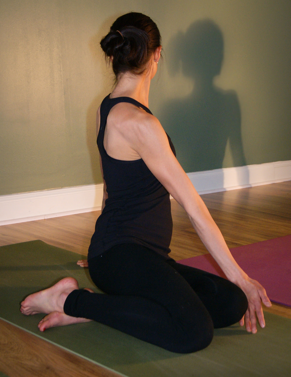 Bharadvajasana - a seated twist. Note the position of the feet.