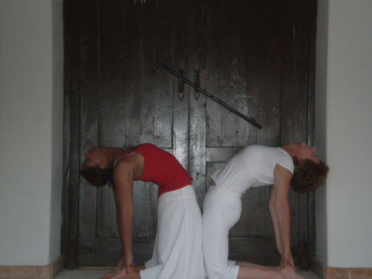 Camel, or Ustrasana stretches the quadriceps at the front of the thighs, as well as strengthening the abdominals and back.