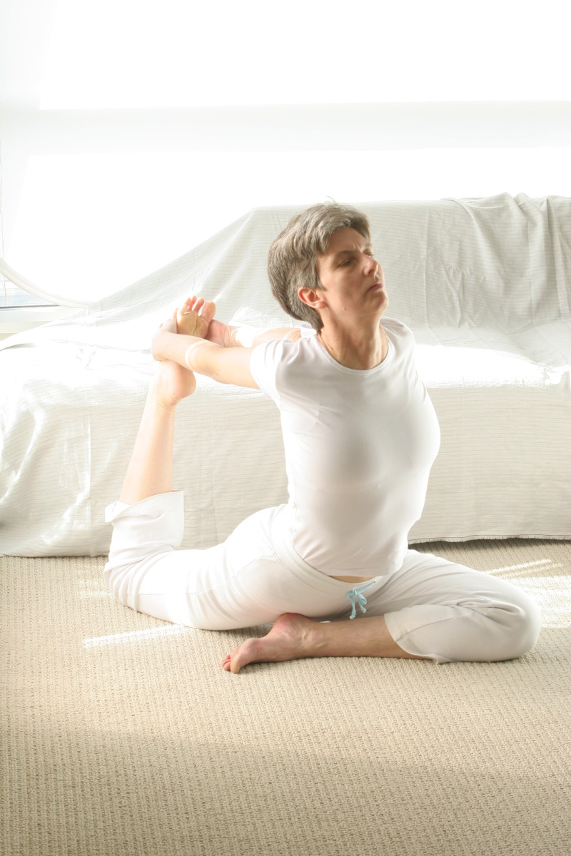 Balancing Pigeon, still deeper variation.  Clasping both hands on the back foot develops the balance and deepens the stretch through both hips.