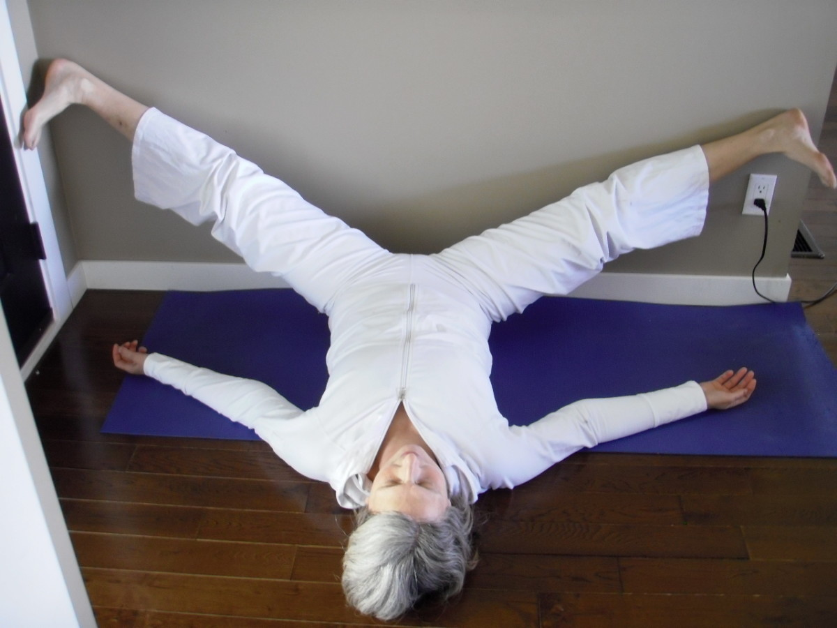 Wide-Legged Legs Up the Wall stretches the backs of the legs (hamstrings) and the inside of the thighs (adductors) to open the hips.