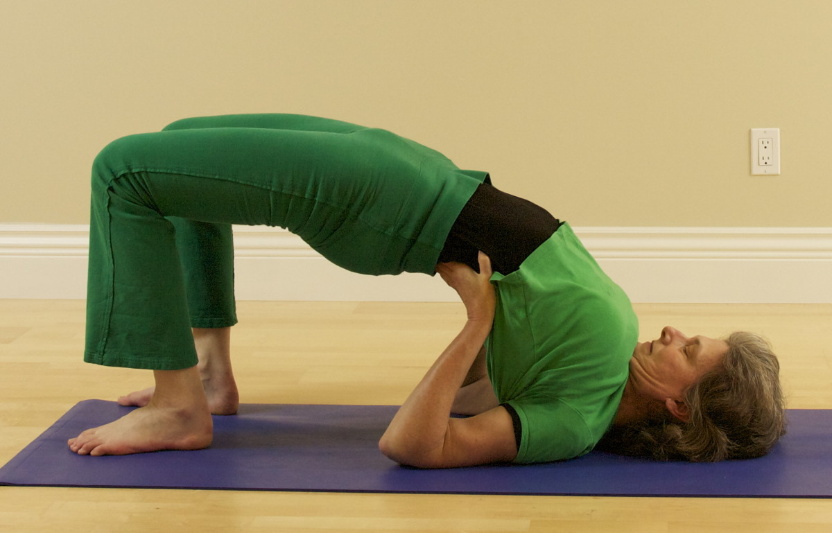 Setu Bandasana, or Bridge, is a preparation for Shoulderstand.  From here, you can kick up into shoulderstand once you have developed the abdominal strength and spinal flexibility.  Or lower for Bridge, and then lift up into Shoulder Stand.