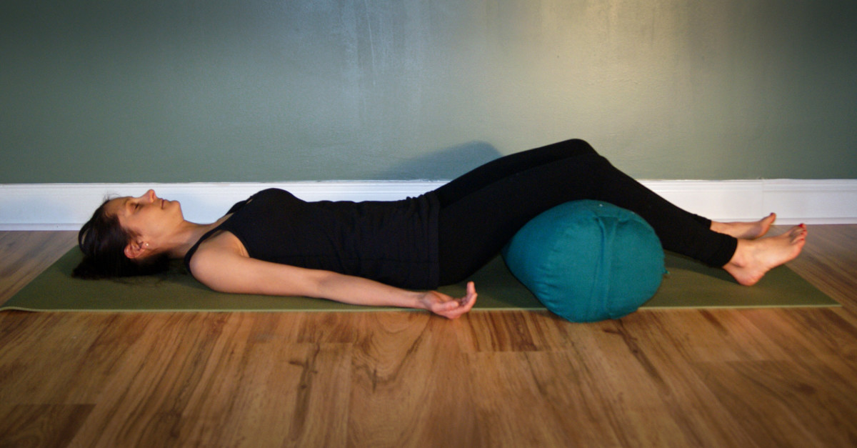 Savasana with a Bolster Under the Knees for Low Back Pain Relief