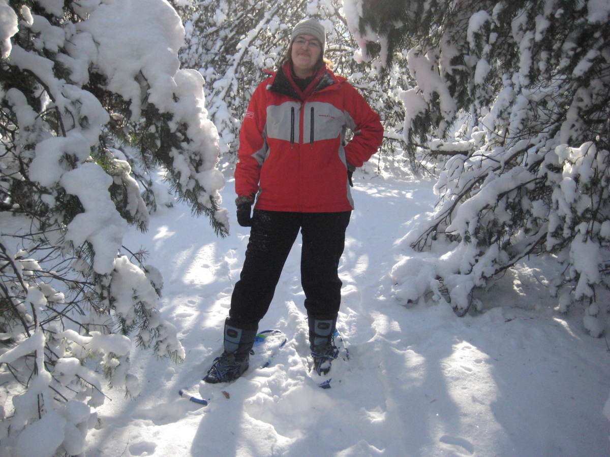 Snowshoeing is a fun activity for a sunny winter day.