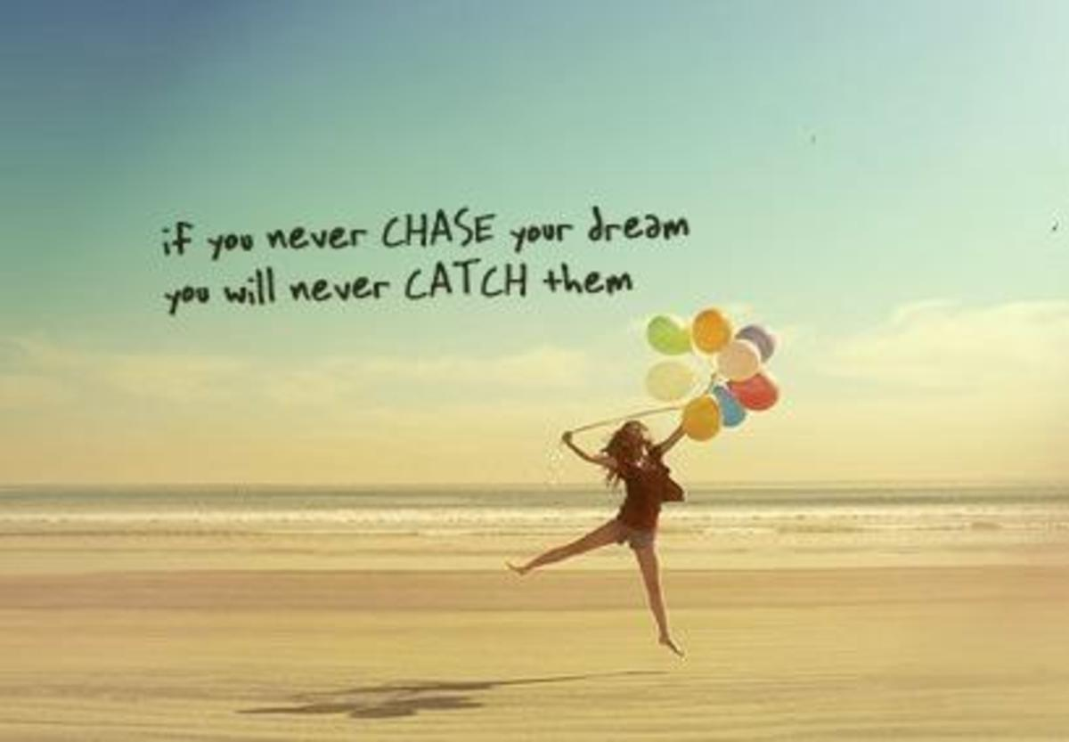 Motivational Poster girl on beach with balloons - If you never chase your dreams, you will never catch them.