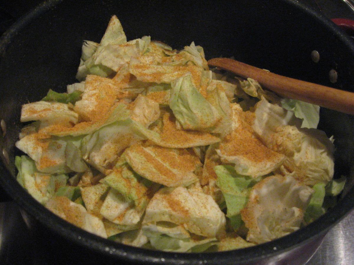 Add cabbage, water, and seasonings.