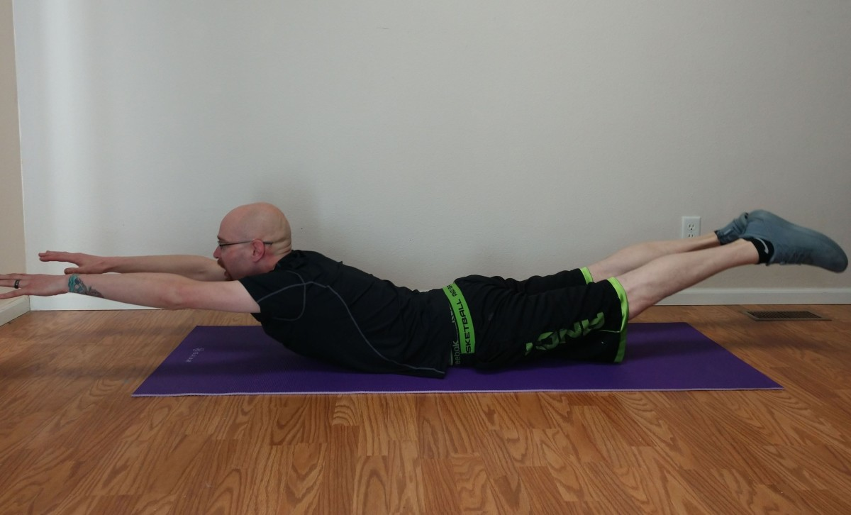 To do the superman exercise, simultaneously raise your arms and legs about 6-15 inches off the floor.