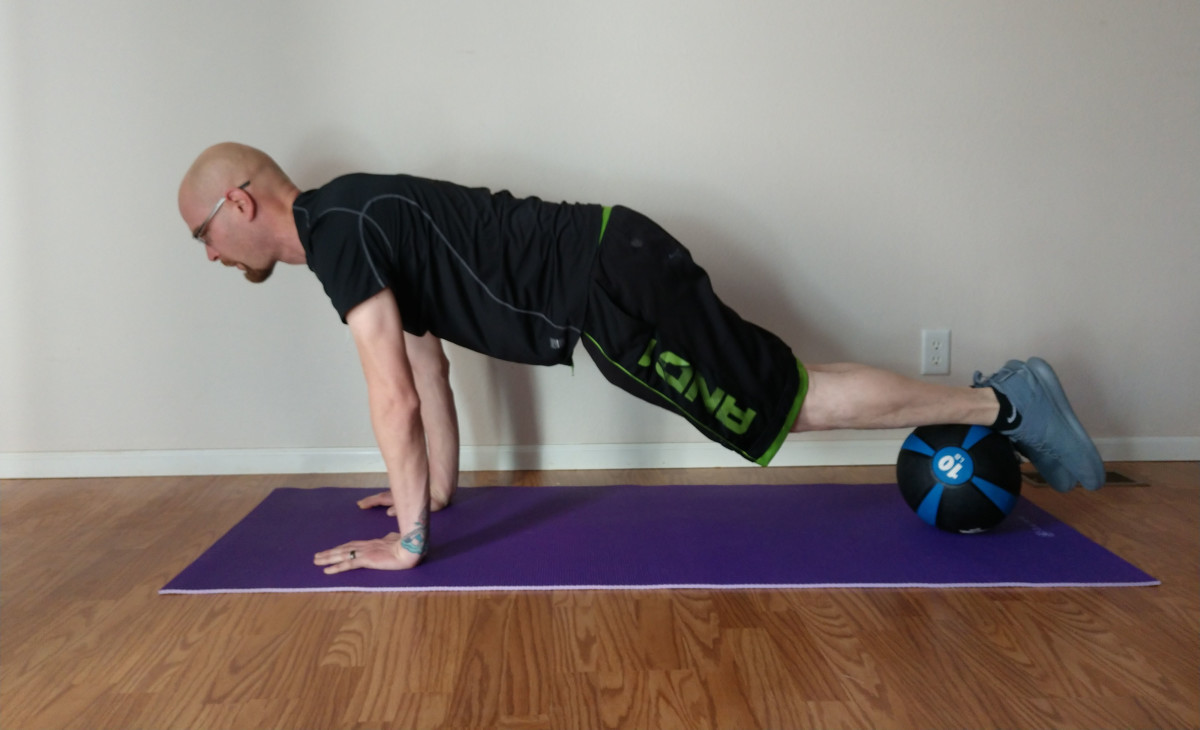 Put your right foot on the ball and stabilize yourself by tightening your abs.