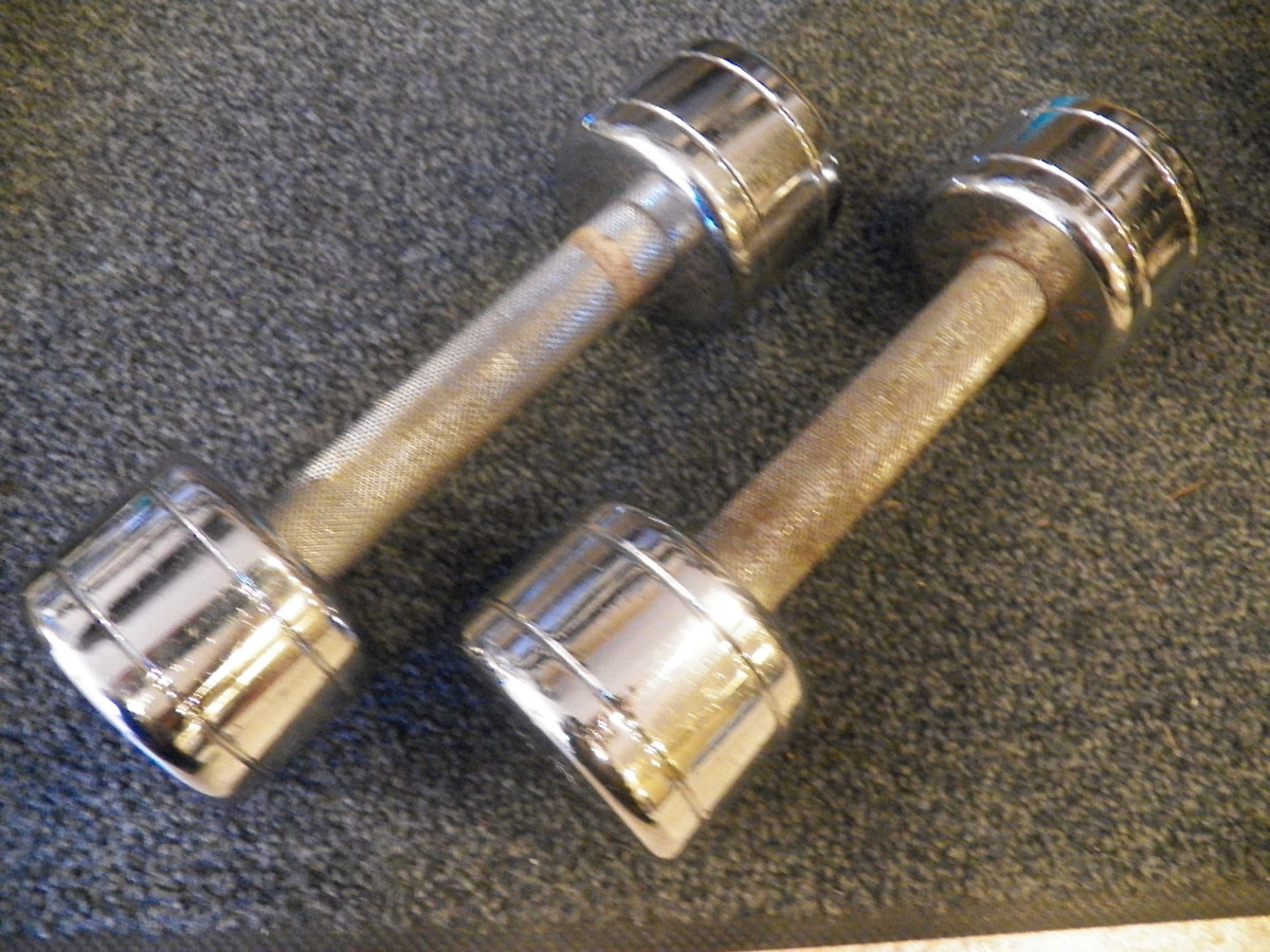 Cleaning chrome dumbbells.