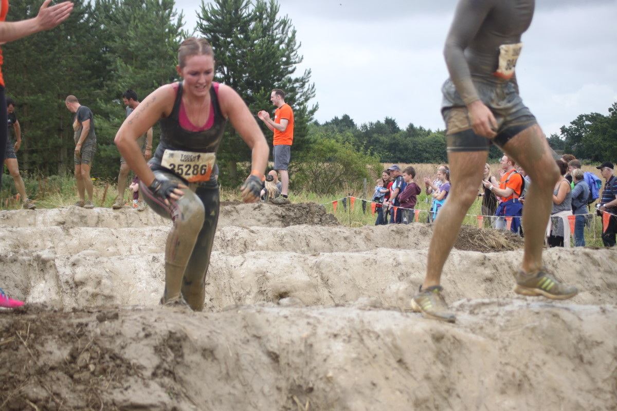 It gets pretty muddy at Tough Mudder!