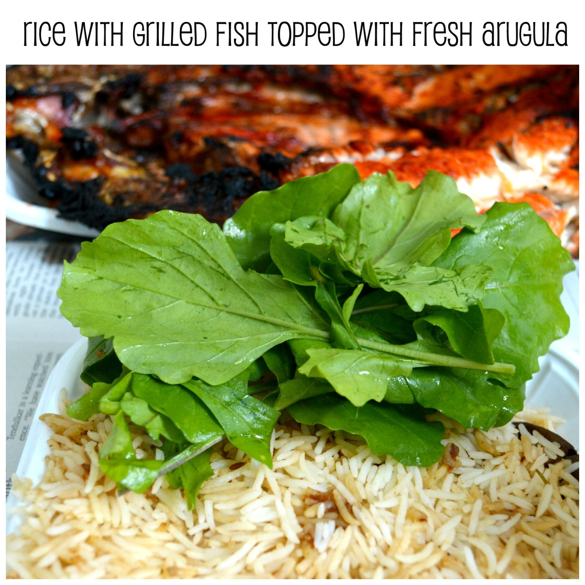A delicious meal of flavoured rice and grilled fish, served with a topping of fresh crisp arugula leaves.