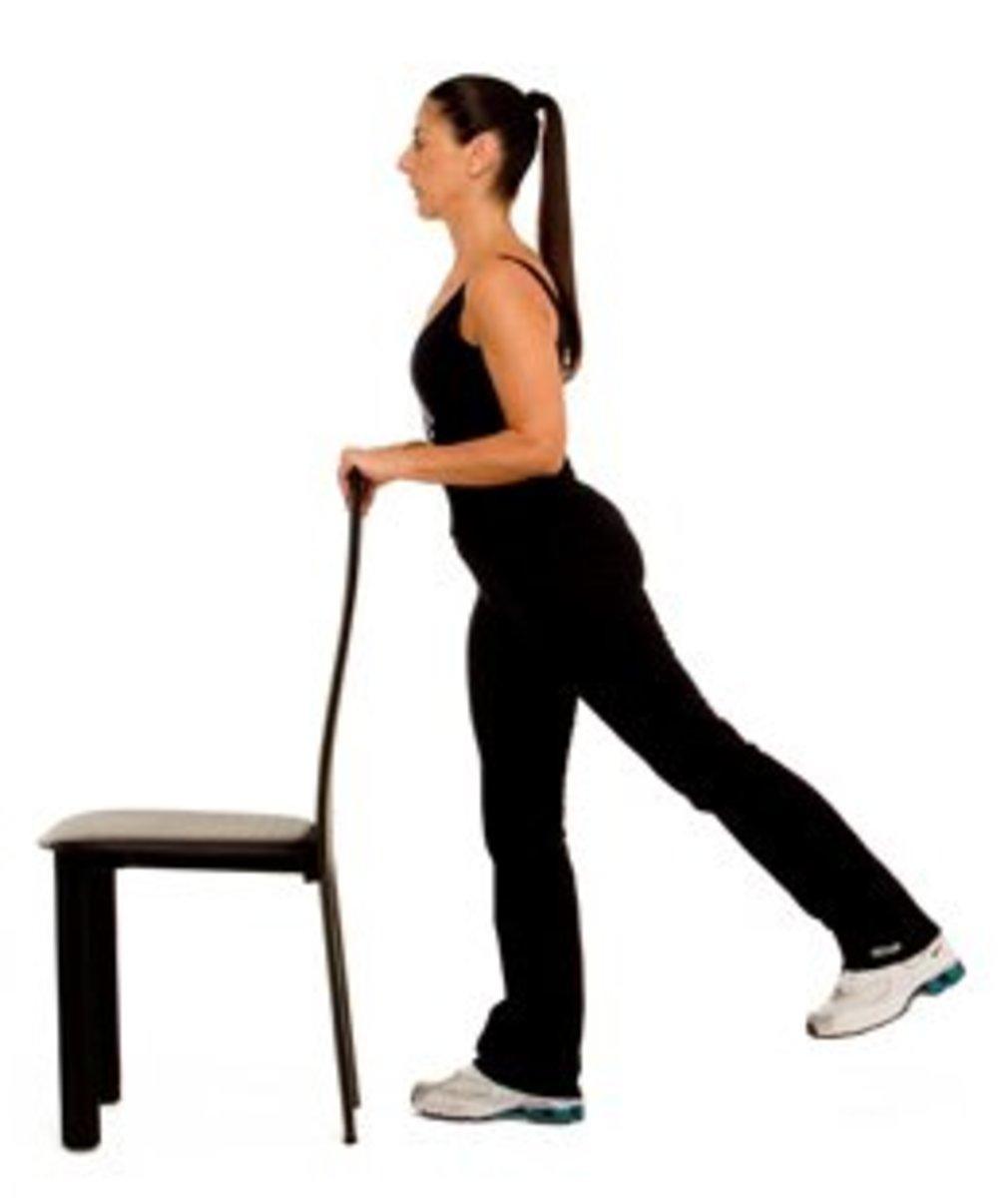standing leg lift - backward leg lift using a chair