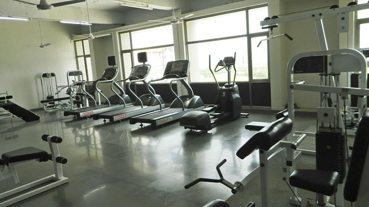 A fitness center featuring equipment.
