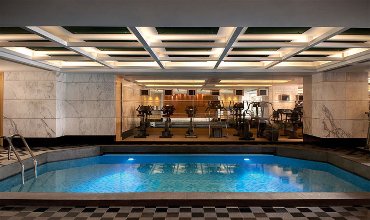 Kowloon Shangri-La Health Club (Hong Kong) featuring pool and equipment