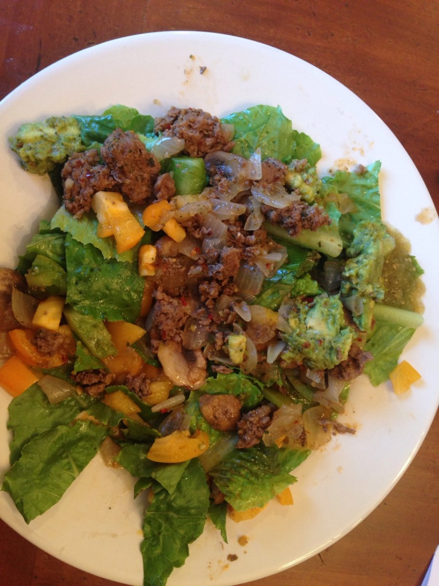 Spicy pepper taco salad: grassfed beef sauteed with mushrooms and onions, leaf lettuce with heirloom tomatoes, simply salsa guacamole, and salsa verde.