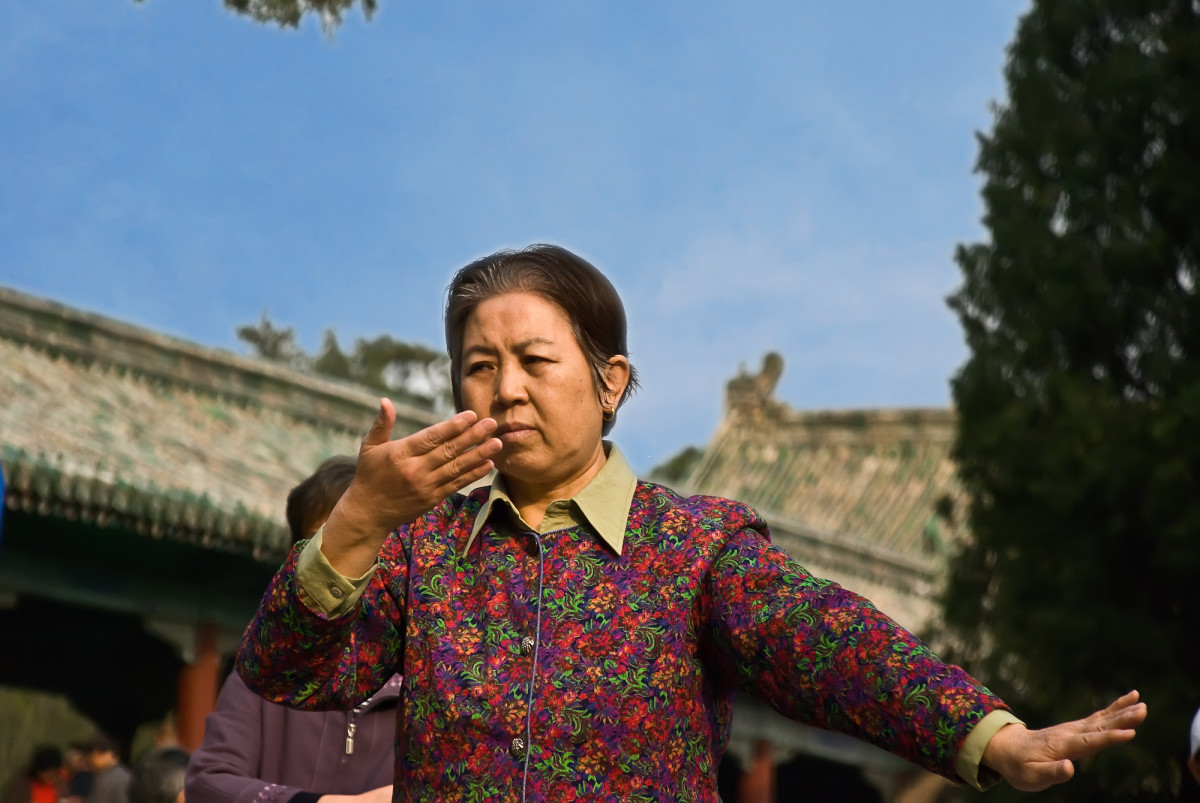 A woman practices tai chi.