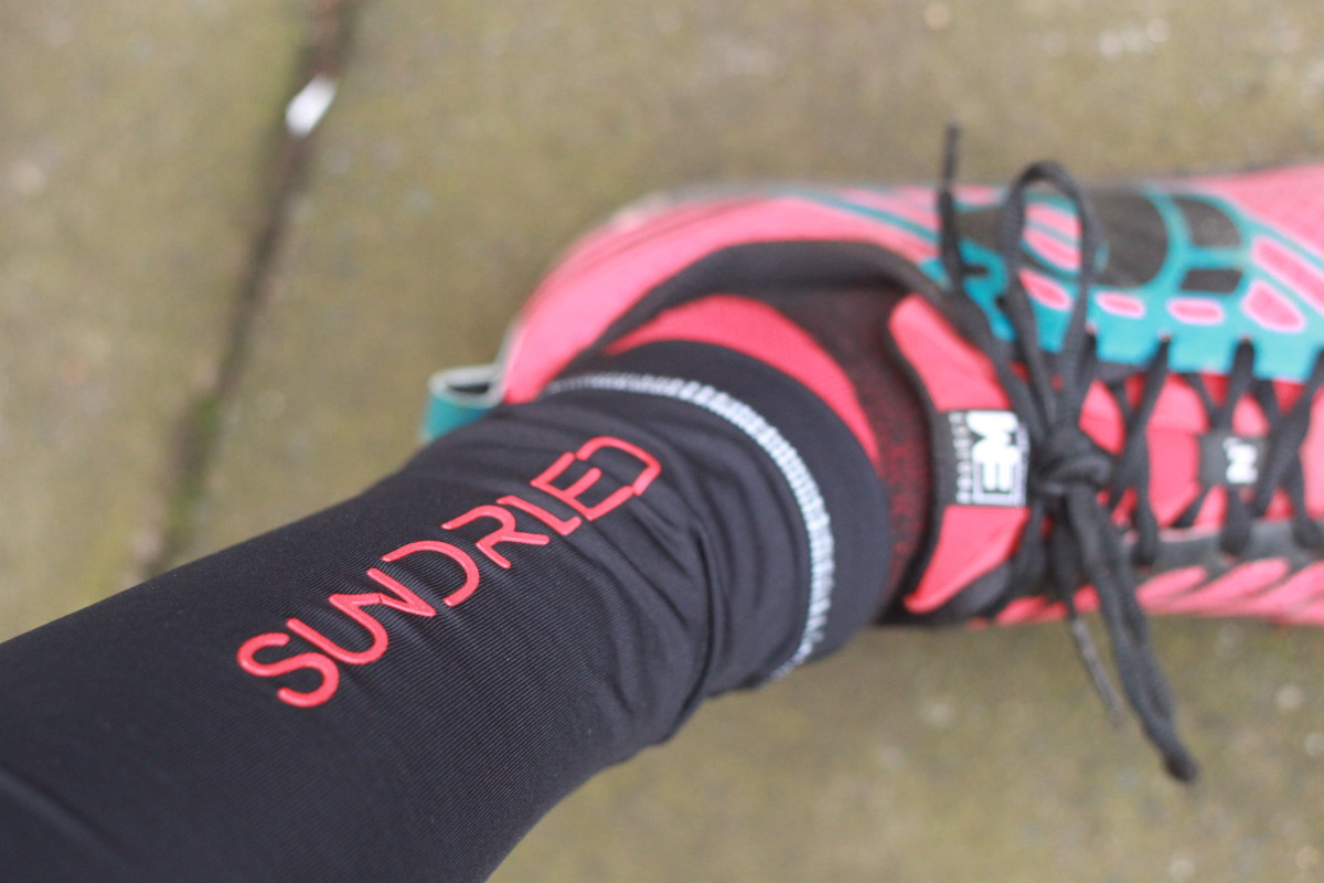 Reflective banding around the ankle of the Sundried Leggings and Pearl Izumi's great Trail m1 running shoes