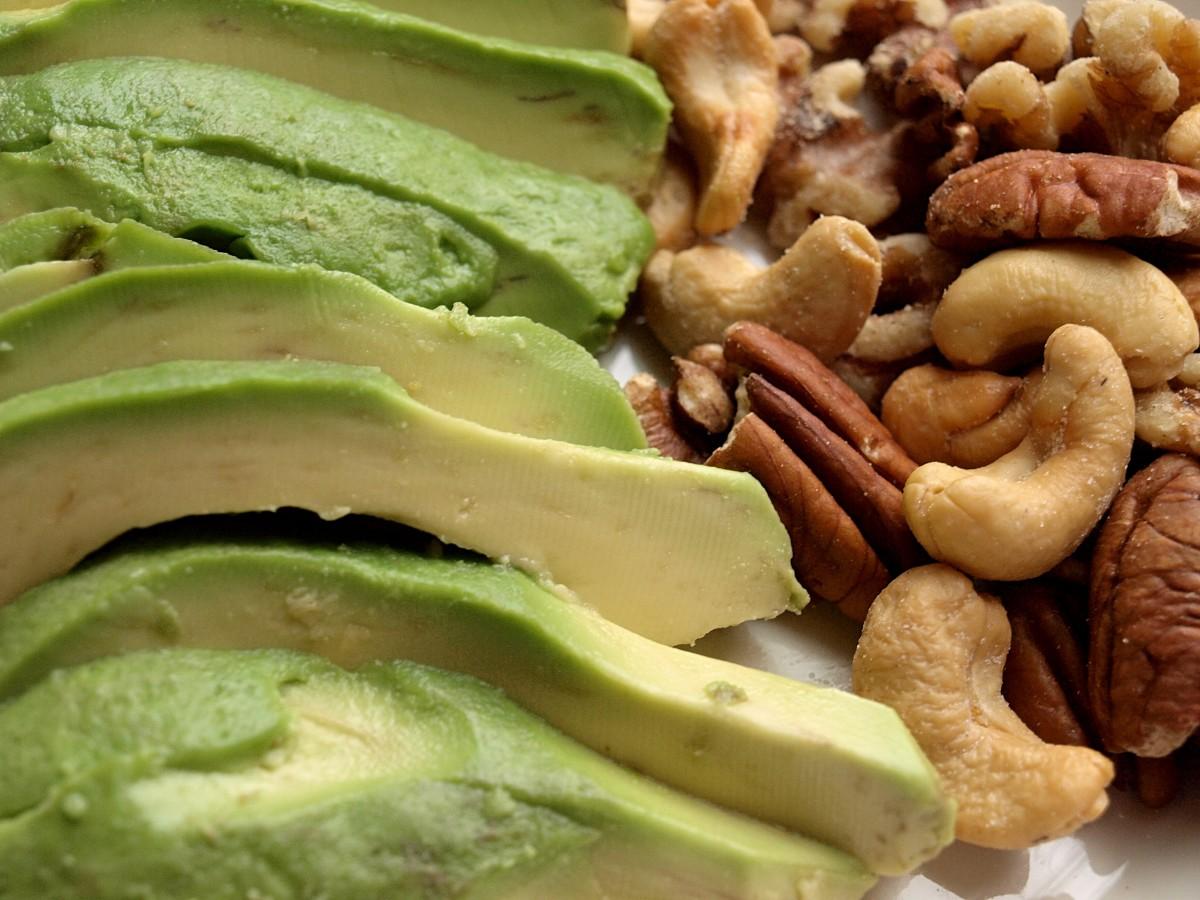 Healthy fats include avocado and nuts.