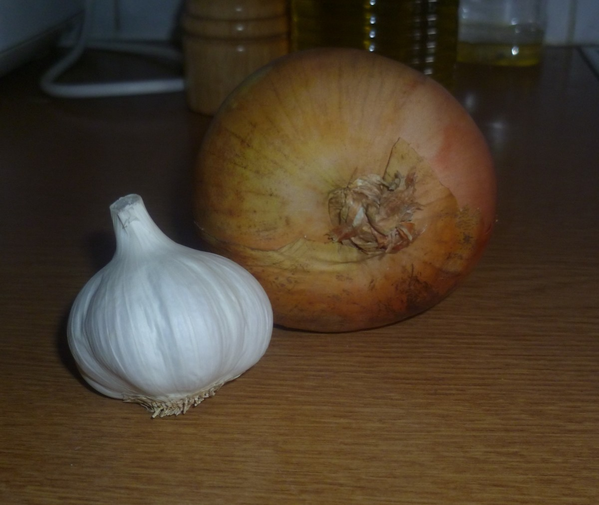 Chop one large onion and 1-2 cloves of garlic to taste.