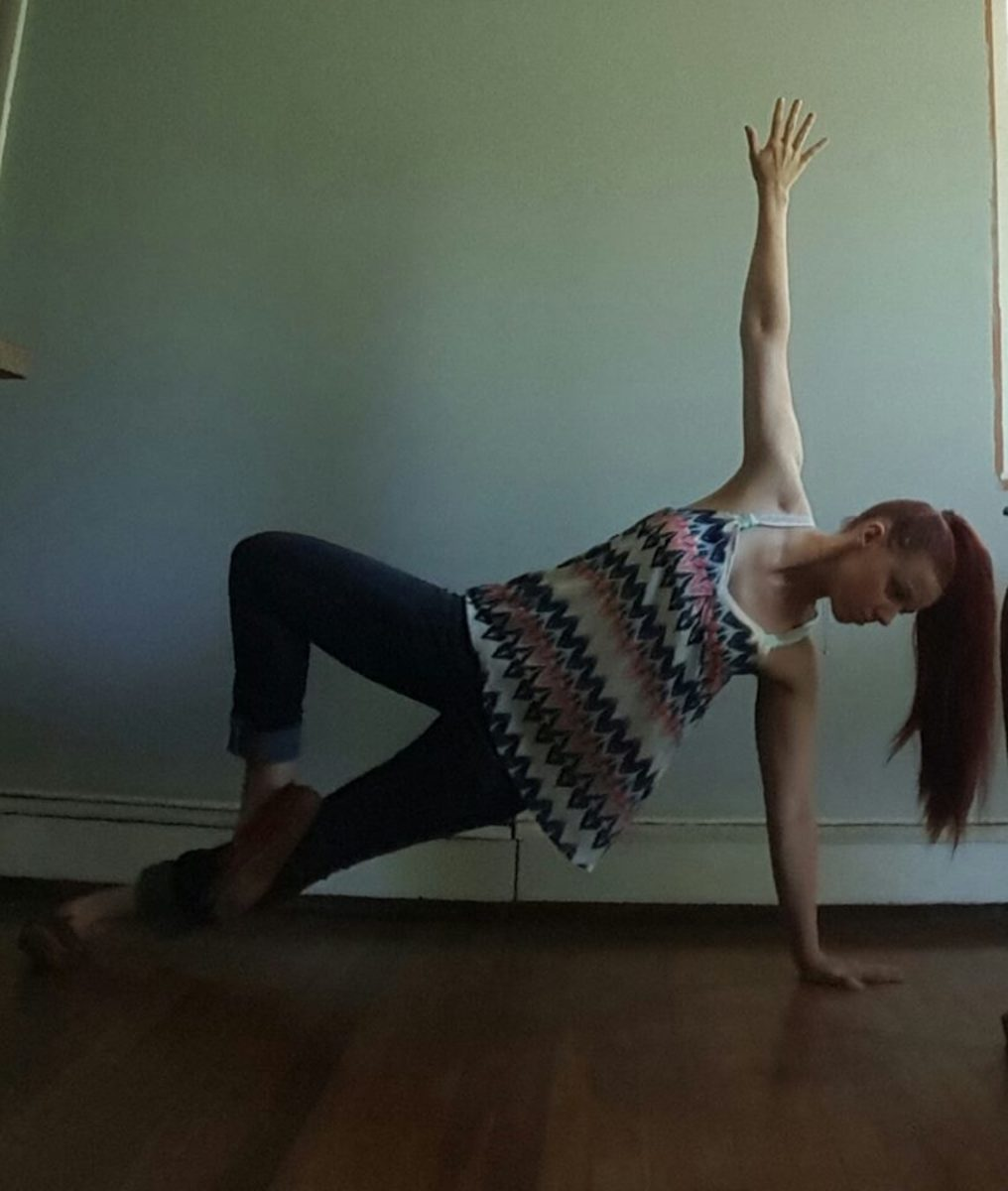 Yoga can be done anywhere, anytime! Me, demonstrating a side plank variation.