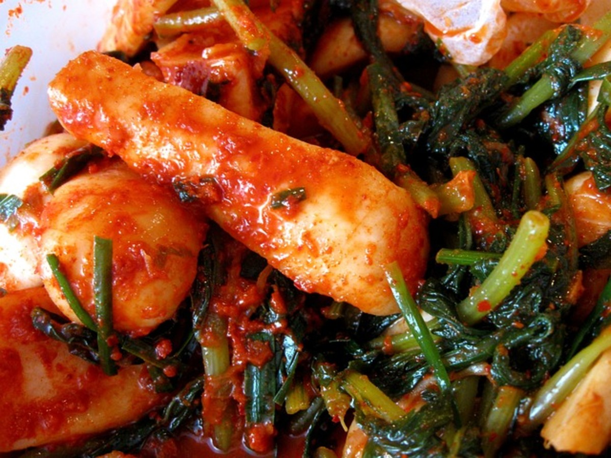 Kimchi is a fermented food made with cabbage, radishes, garlic, and spices.