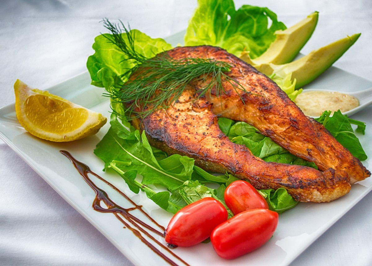 Pan fried salmon is a good, healthy choice.  Don't forget that you need to add some fat to the meal!