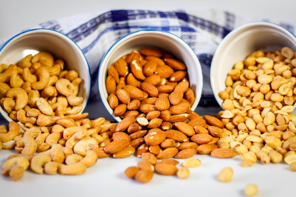 Nuts provide vitamin E and are a healthy source of fats in a vegan diet.