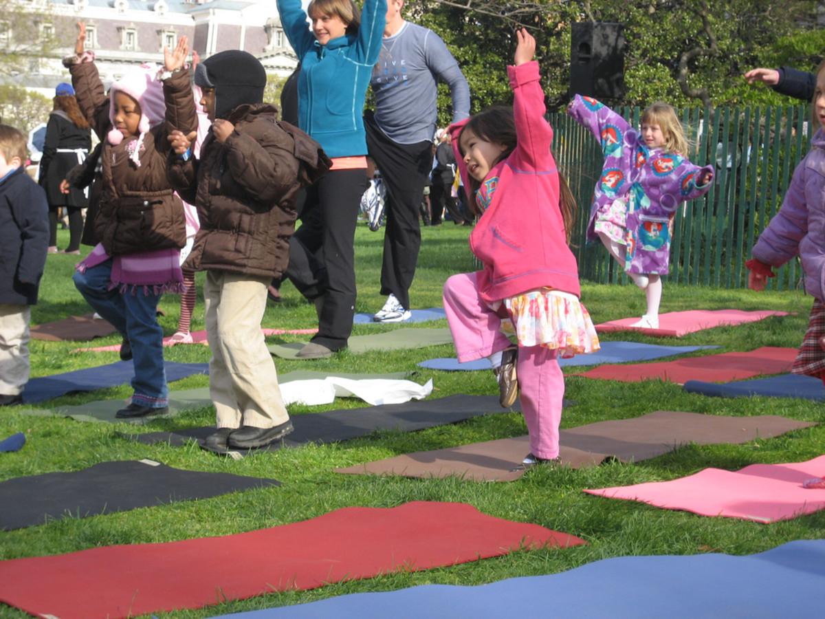 An outdoor yoga class for children.