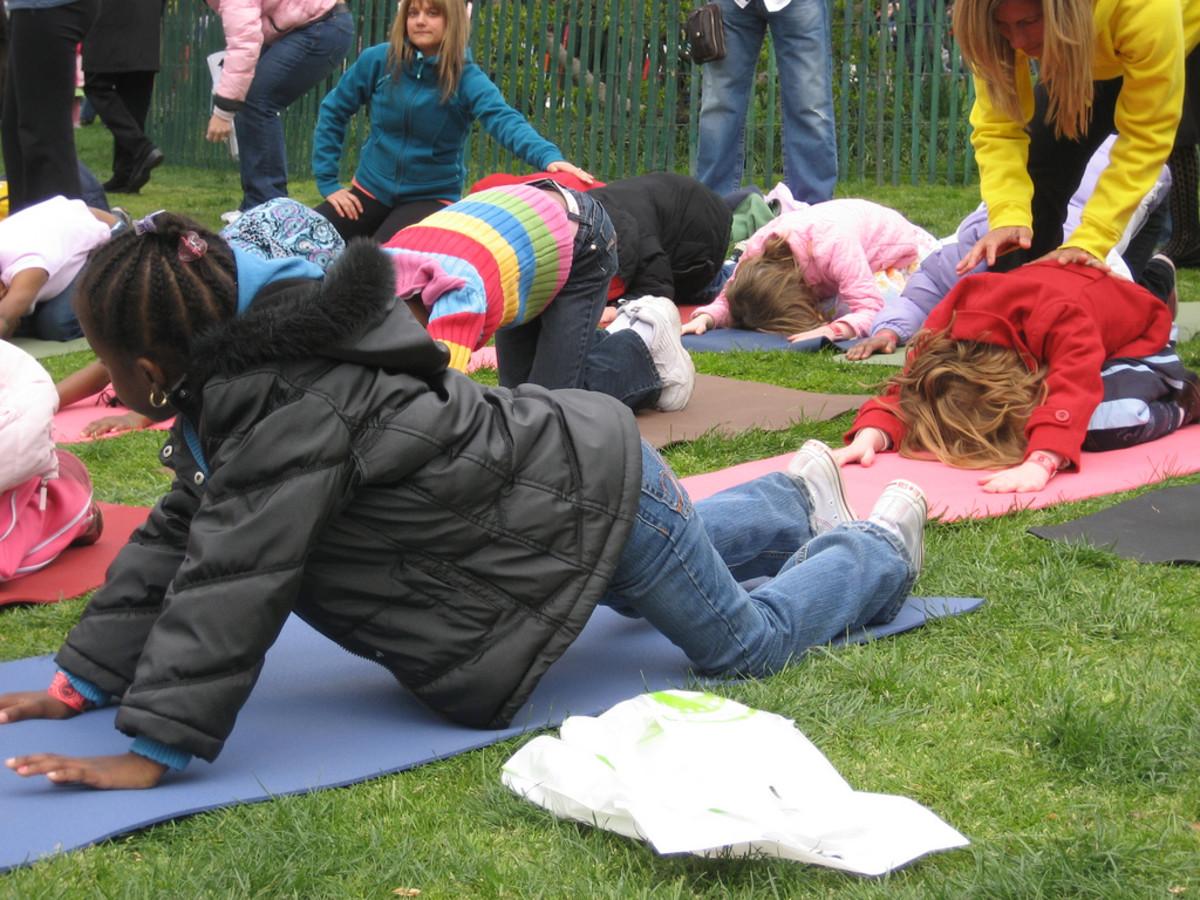 An outdoor yoga class for kids.