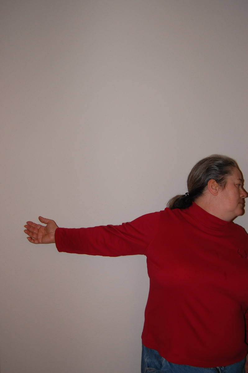 To perform one side at a time, hold out arm and press backward, while turning your head the opposite direction