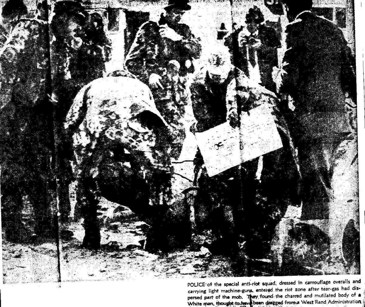 "The caption of this picture in the Natal Mercury of 17 June reads: ""Police of the special anti-riot squad, dressed in camouflage overalls and carrying light machine guns, enterd the riot zone after tear gas had disperssed part of the mob. They found"