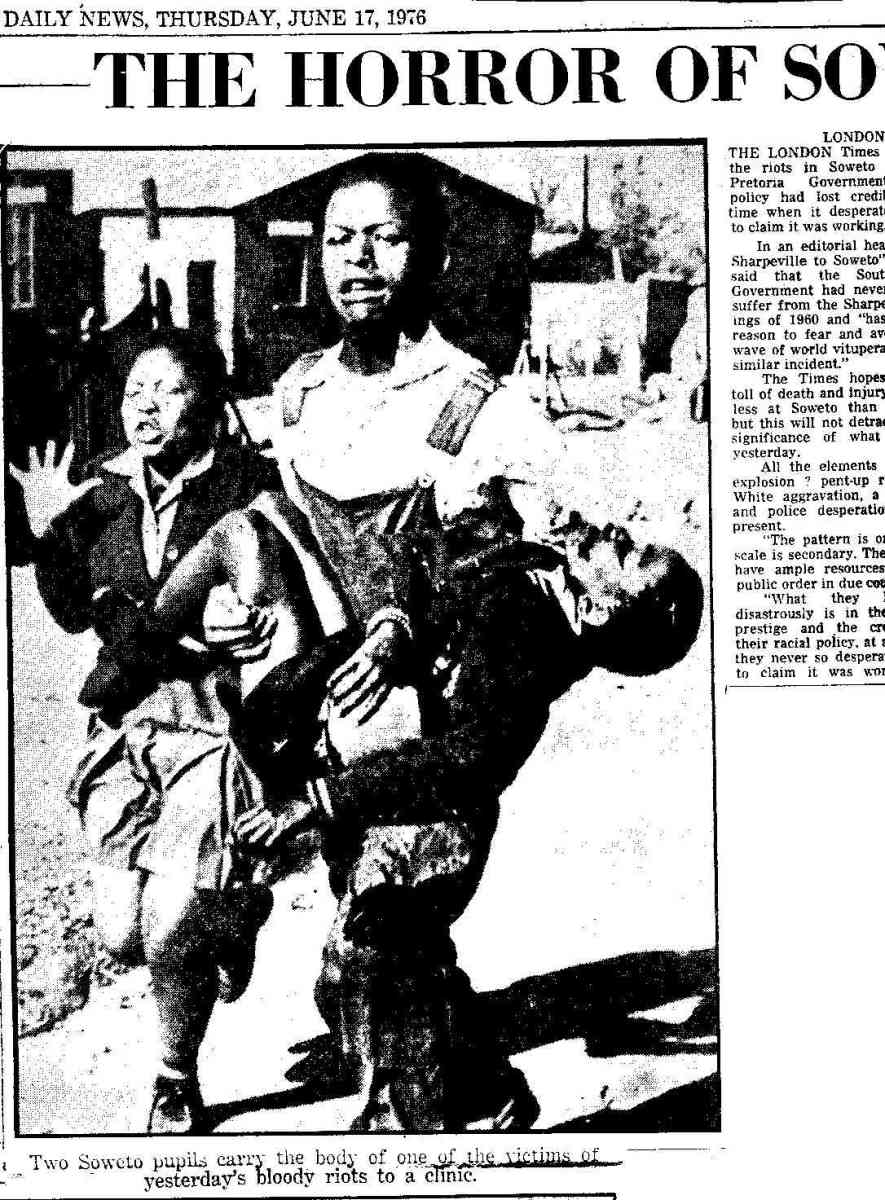 The first student killed by the police on that fateful day was 12-year-old Hector Pieterson, seen here being carried away from the scene by a friend. With them is Hector's sister Antoinette. Photo taken by Sam Nzima