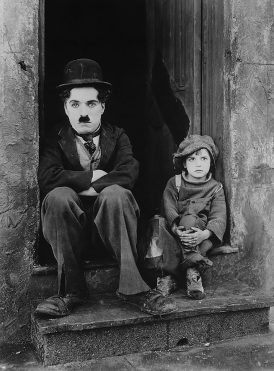 Charlie Chaplin and a little boy in a black and white photograph