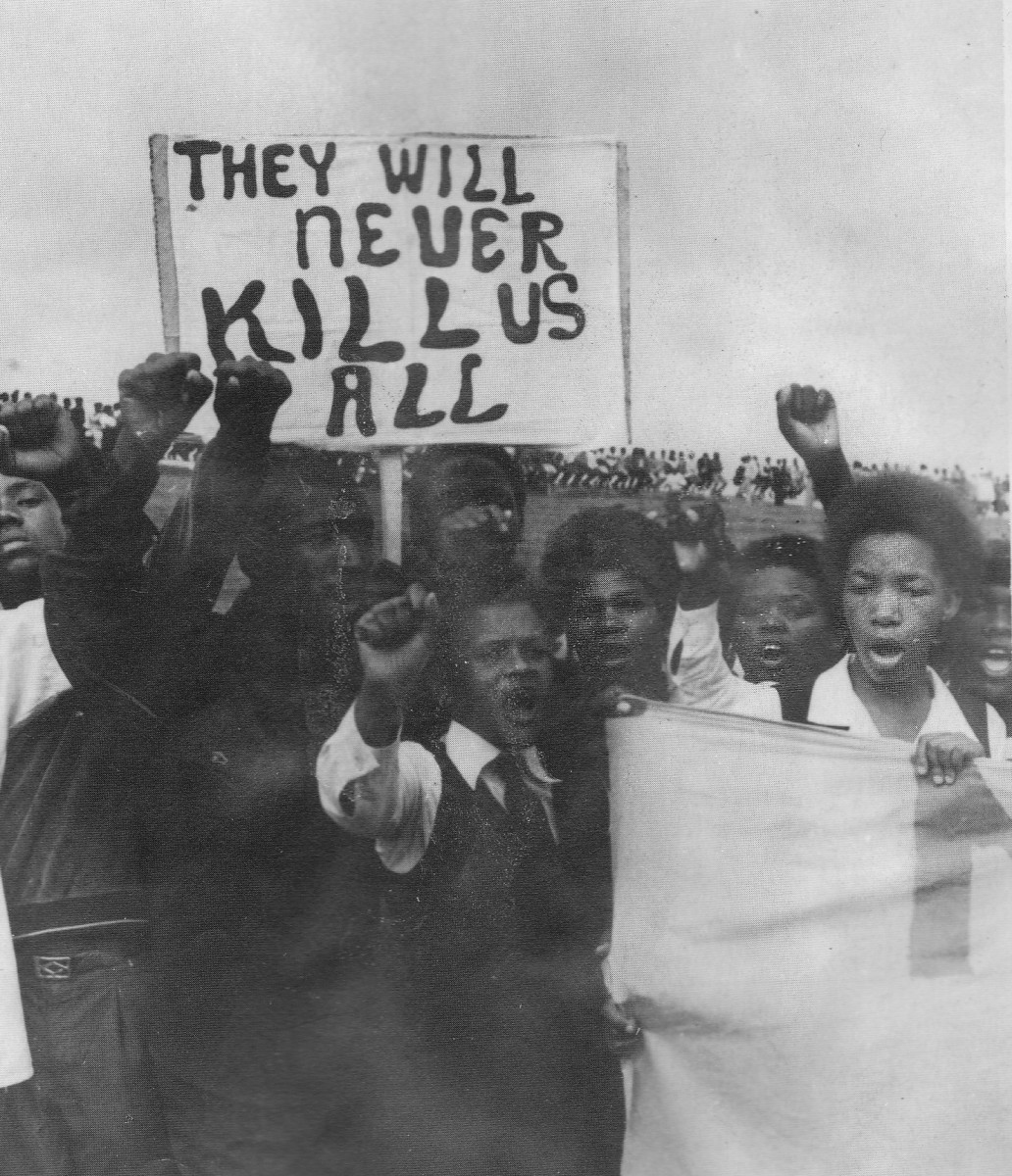The Poster from the youth says it all. 100,000 Attended this funeral at Kwanobuhle Stadium, in Uitenhage. to show their anger and resolve
