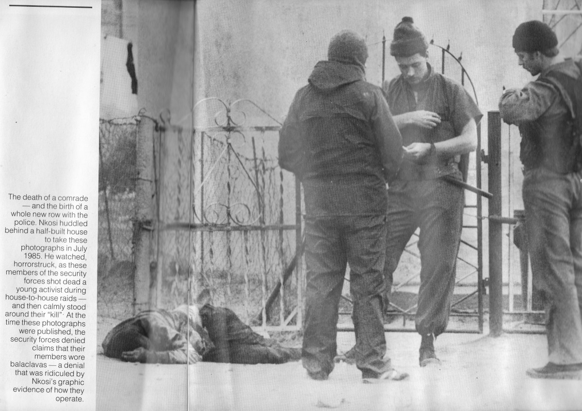 """Members of the security forces shot a young activist during house-to-house raids. Members of the security forces calmly stand next to their """"kill""""; Below, the members of the security forces denied wearing 'balaclavas' but were exposed by this photos"""