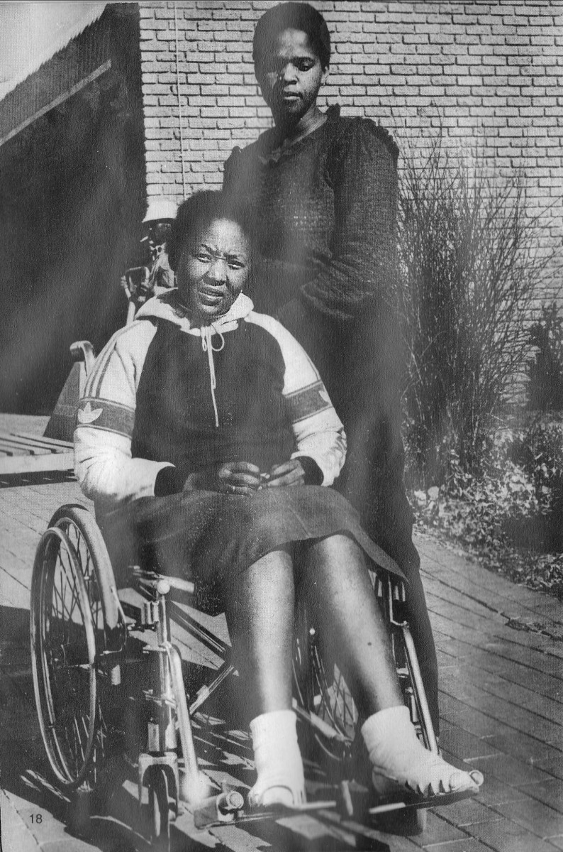 Poppie Buthelezi(on a wheelchair) and Phindile Mavuso, both wounded by police bullets during the Soweto 1976 students revolution