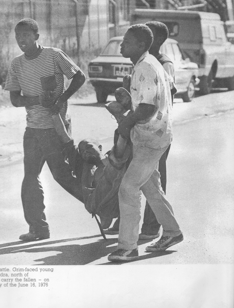 A victim of SADF snipers carried by his comrades, and the person later died from gunshot wounds