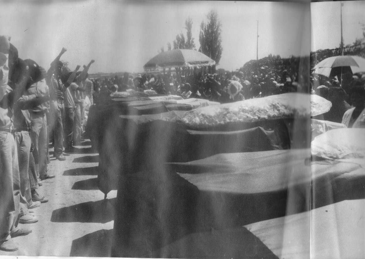 """The aftermath of the Alexandra Township """"Six Day War"""" in February 1986. Seventeen people were buried at a mass funeral in Alexandra Township for those shot dead by the police."""