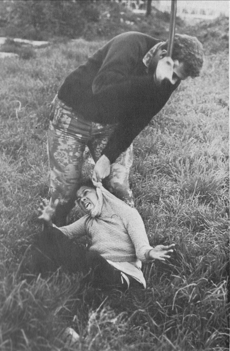 A policeman beating a child with a sjambok