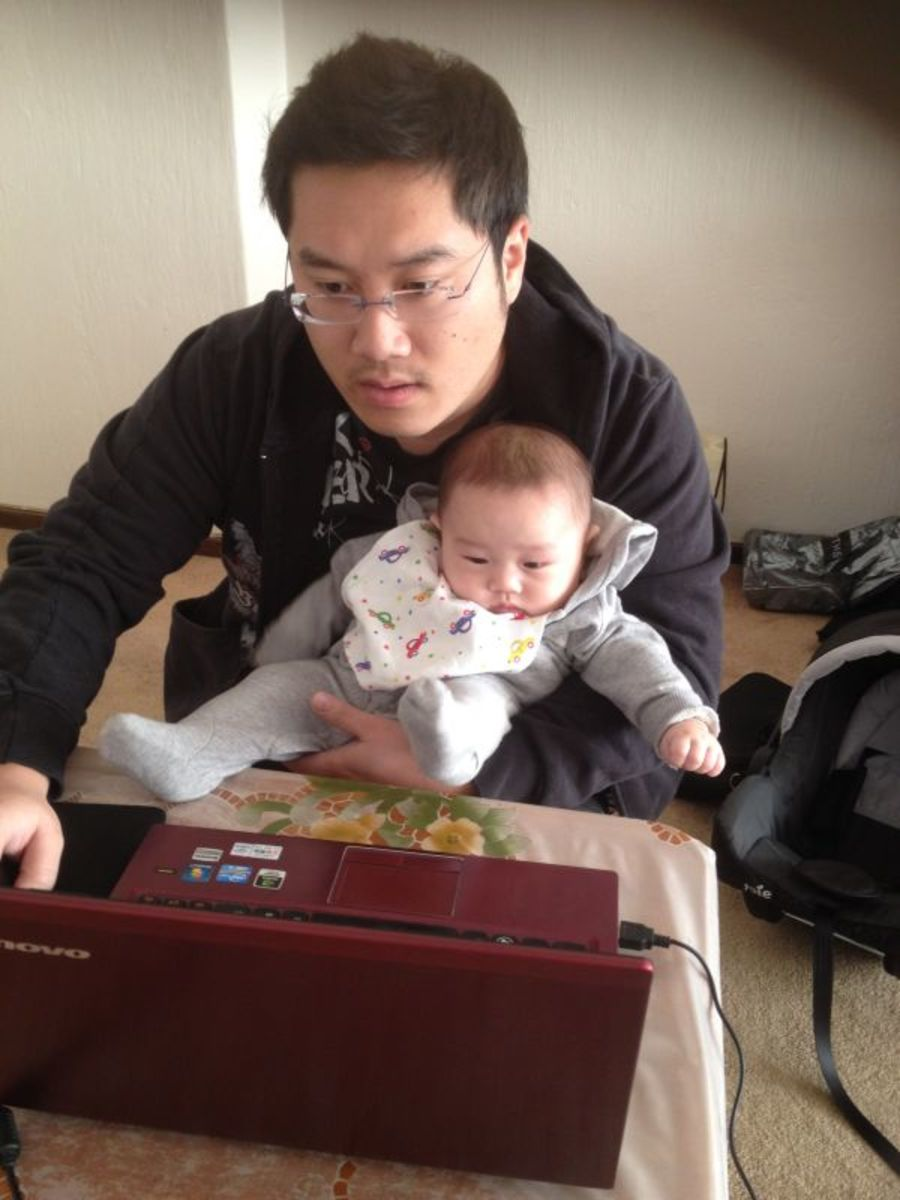 "July 2014, South Africa. Playing Online games and ""looking after"" my son."