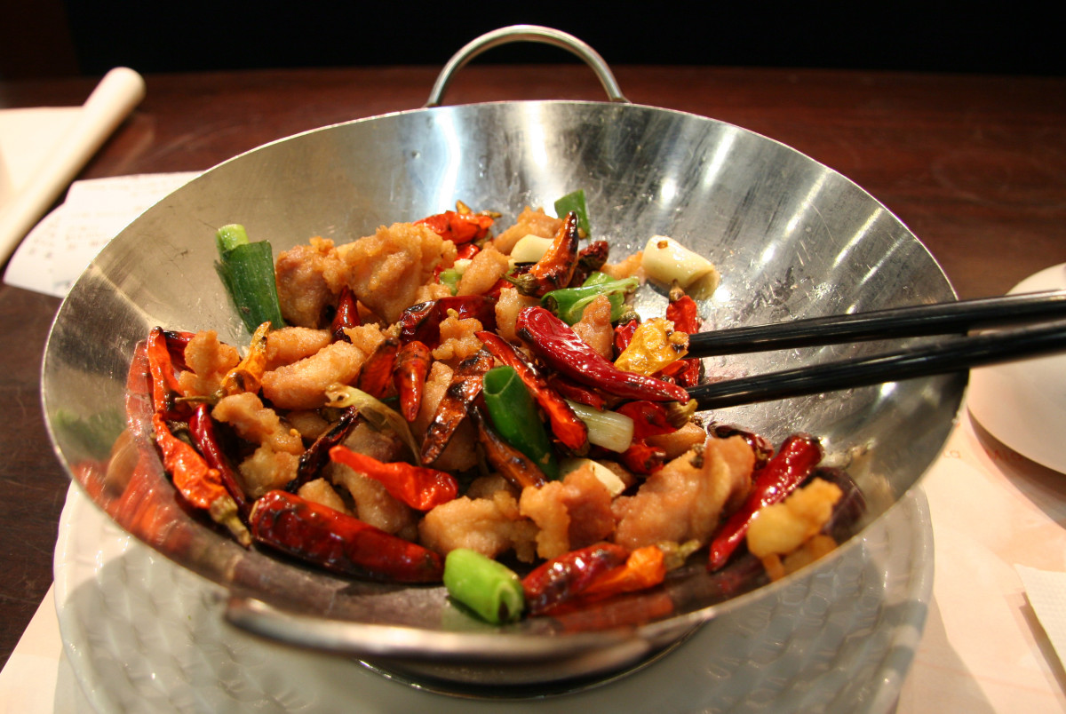 No, not all of us cook with woks.  It's only used in Chinese cuisine for the most part and no, I don't own one!