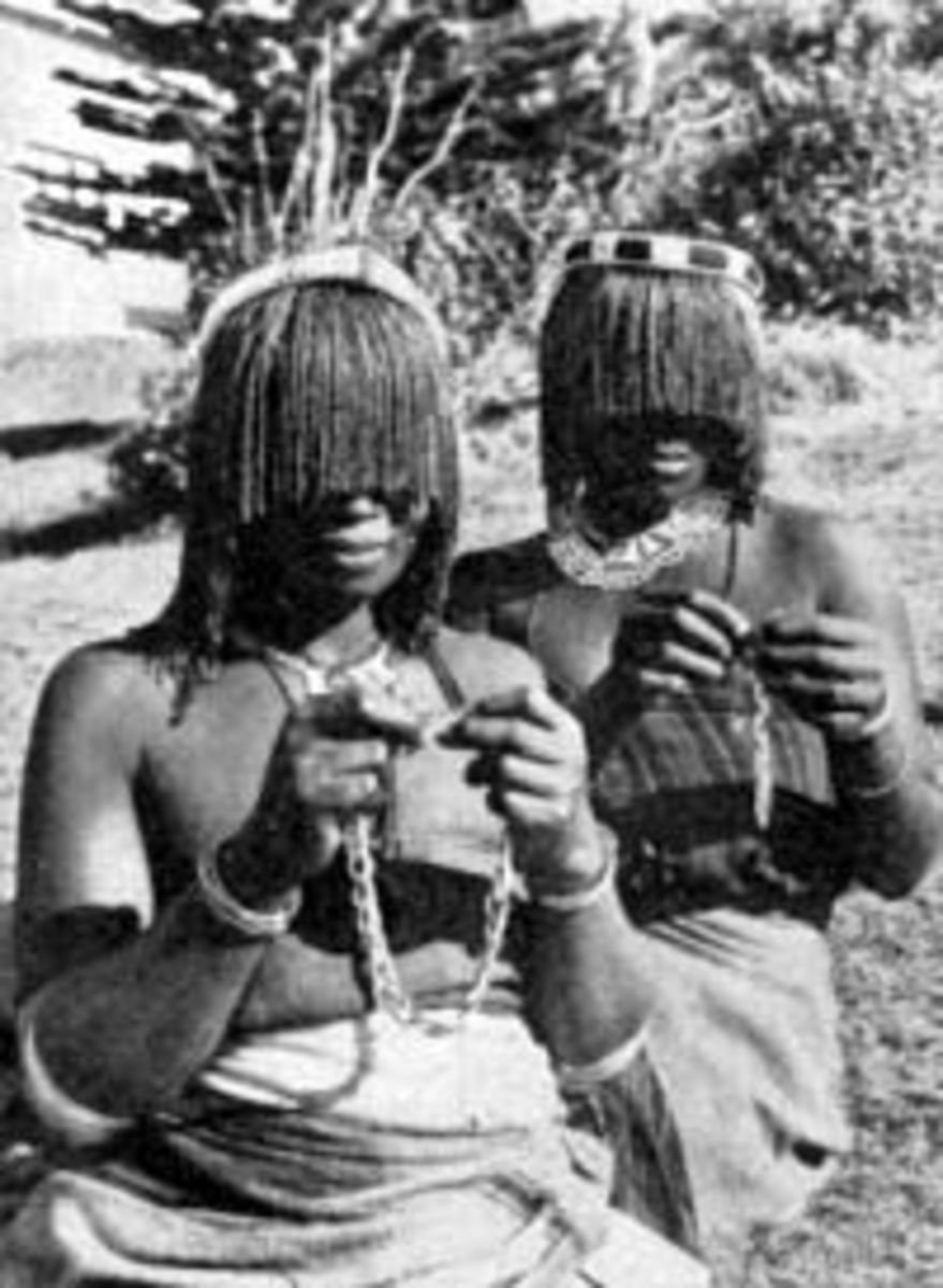 Pondo Women who are part of the Xhosa people who belong to the 9 groups that make the Nguni/Bakone people of South africa. Here they are seen donning their traditional hair-do.