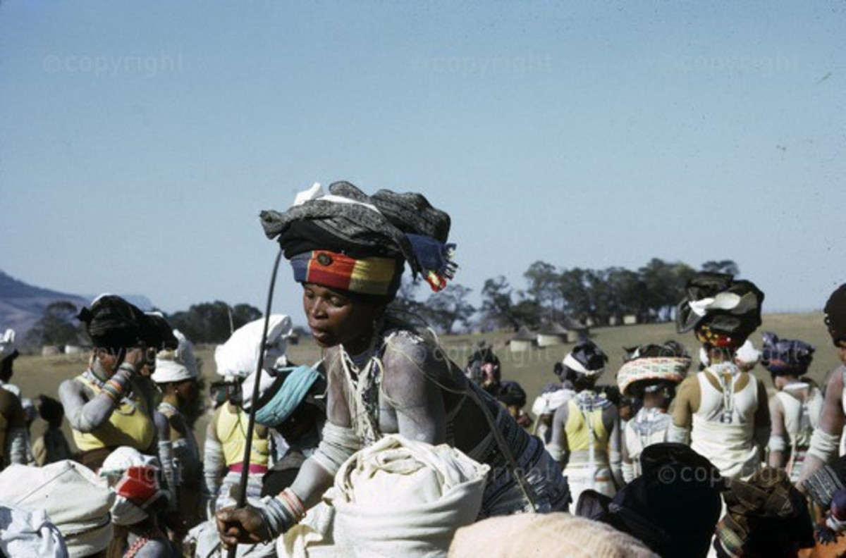 Thembu-Xhosa Female intonjane Initiation at Qutubeni in Transkei Province,SA. Circa 1965. Intonjane is a rite of passage for girl to welcome them into womanhood.  During intonjane, a girl is secluded at her homestead, where she is taught womanhood va