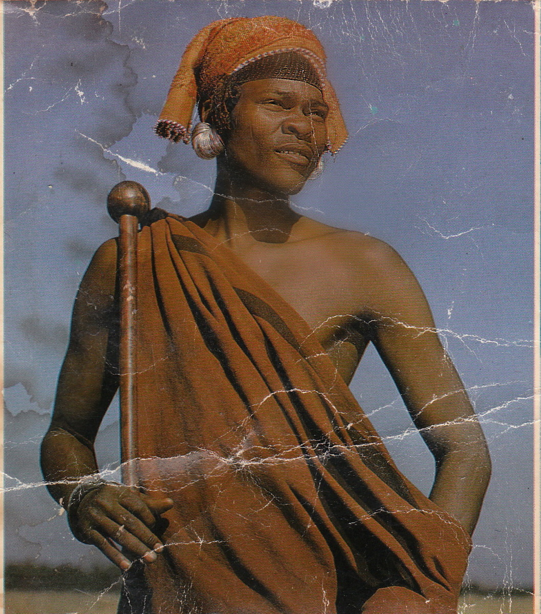 "A Pondoman in his traditional garb and holding an ""iqakatha""(a knob-kierrie)"