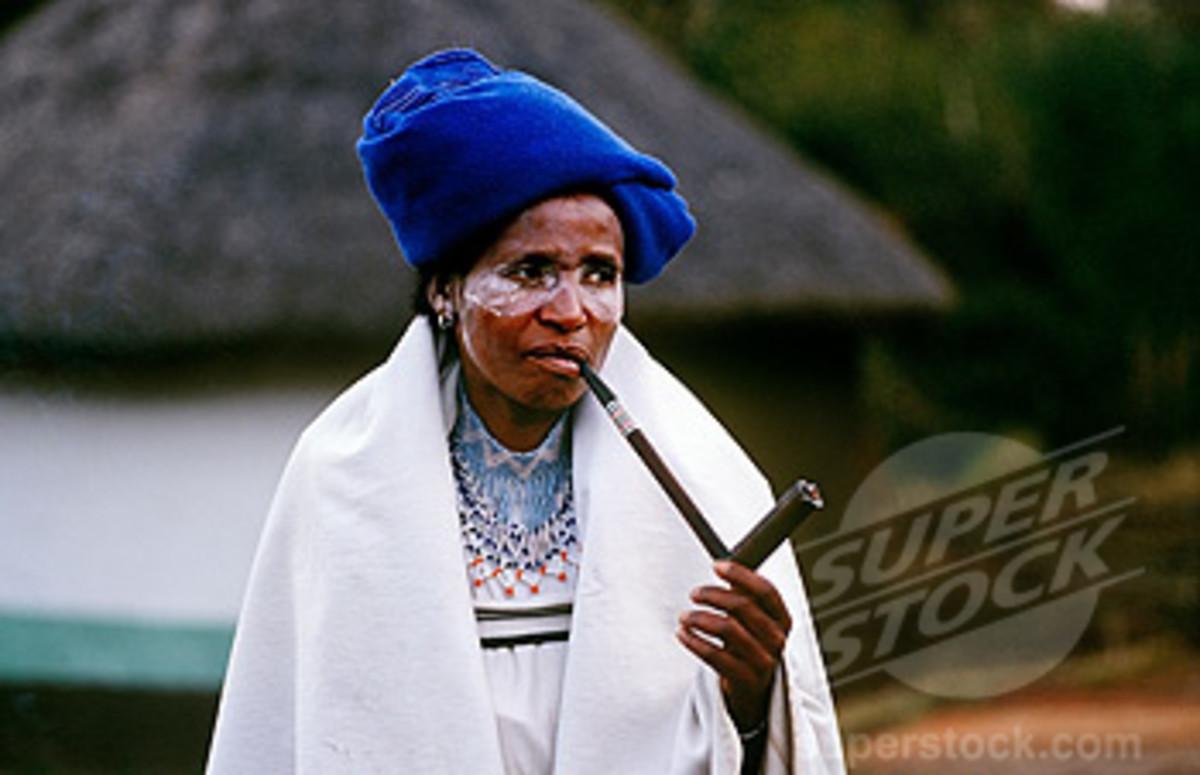 Xhosa Woman smoking Her traditional Pipe